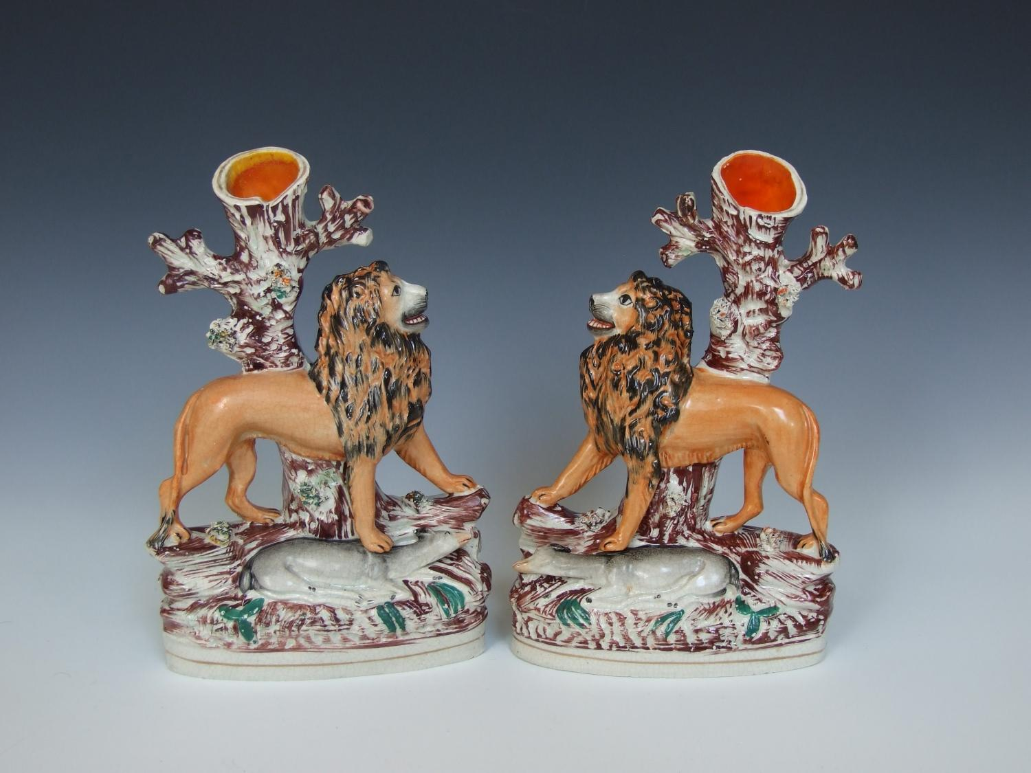 Rare pair of Staffordshire lion spill vases