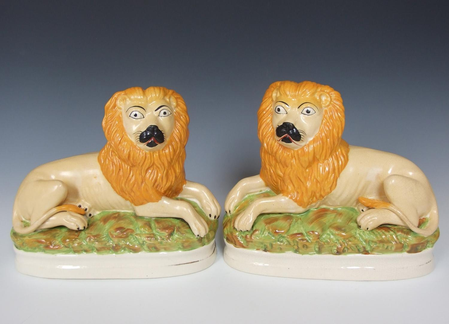 Rare pair of large Staffordshire lions