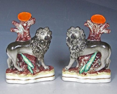 Rare pair of Staffordshire lion spills