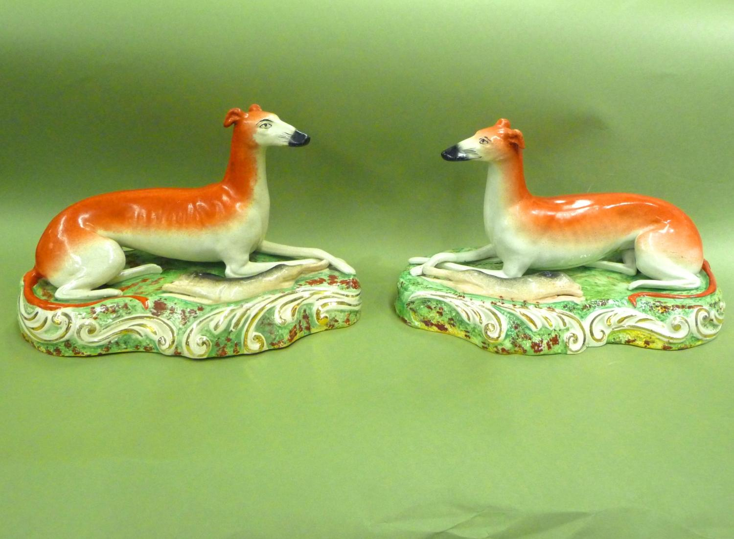 Large pair of lying Staffordshire greyhounds
