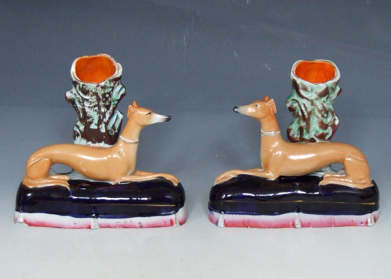 Pair of greyhounds on cobalt blue cushions