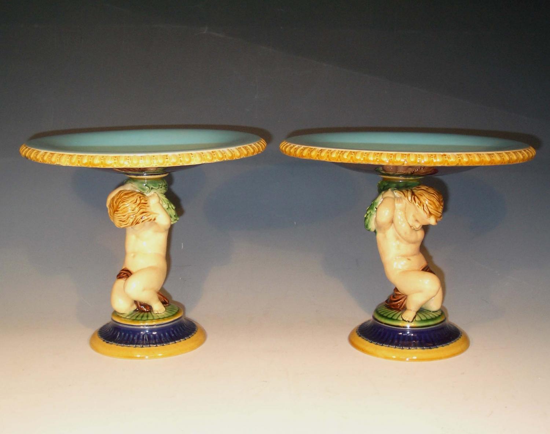 Pair of Minton majolica cherub tazzas