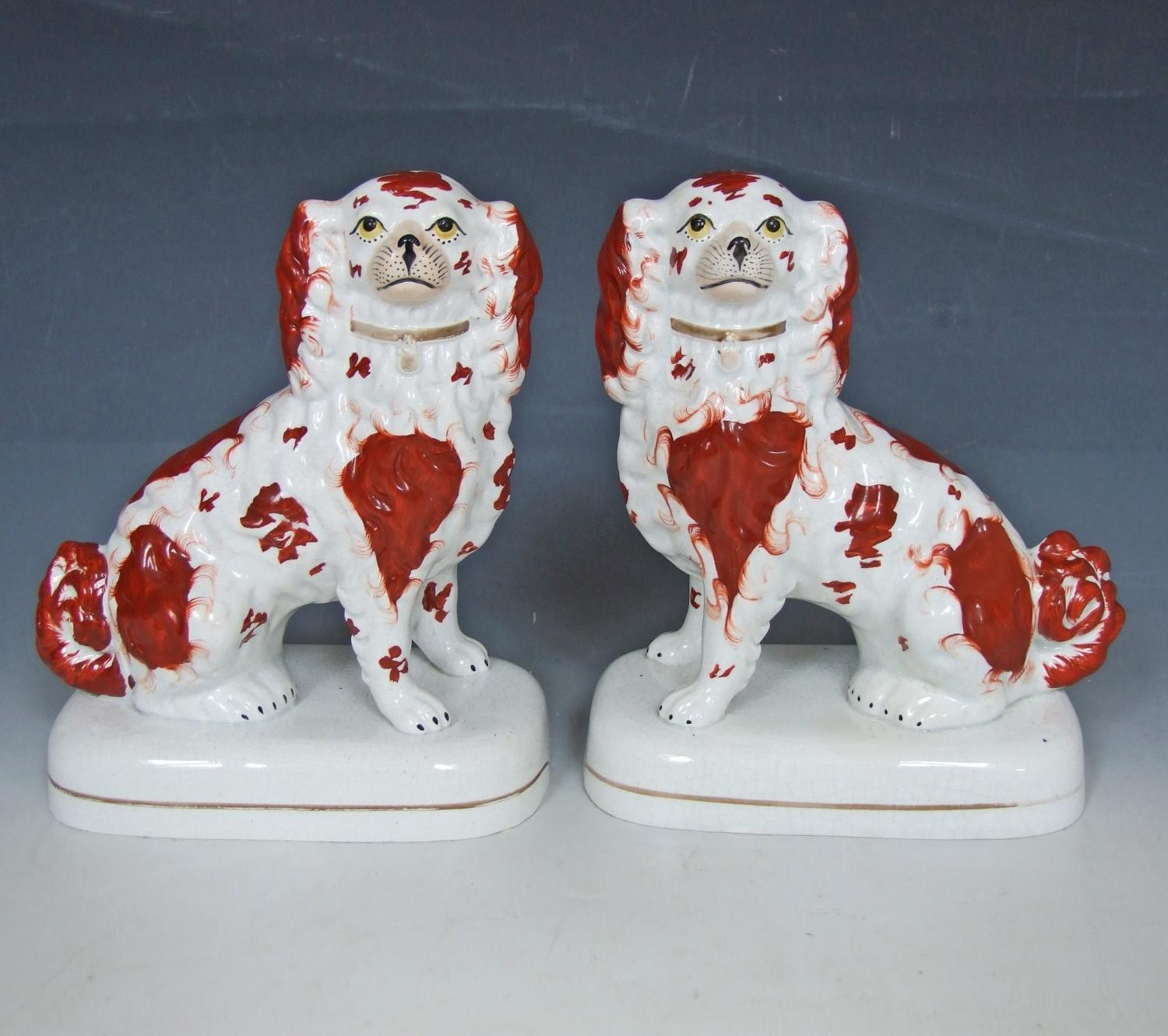 Pair of raised base Staffordshire spaniels