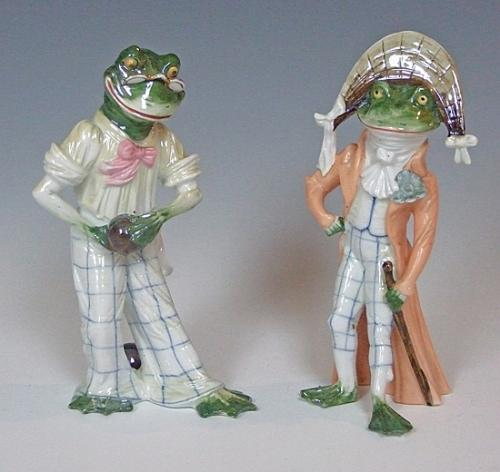 A whimsical pair of porcelain frog figures