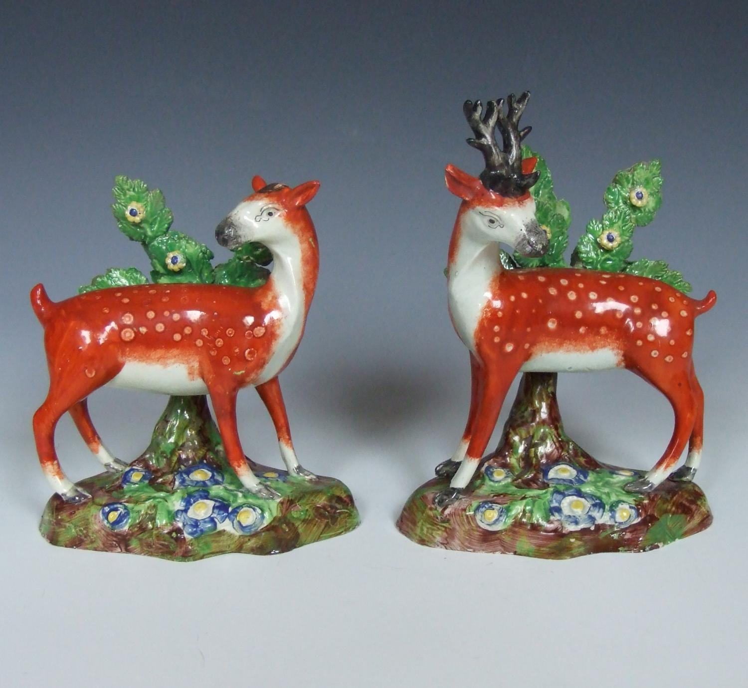 Pair of early Staffordshire stag figures