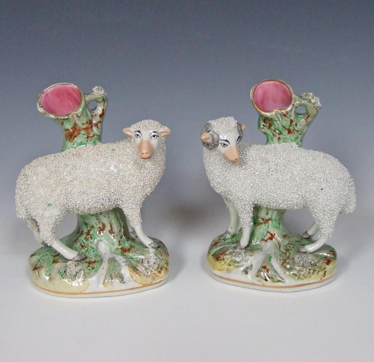 Pair of large Staffordshire sheep spills
