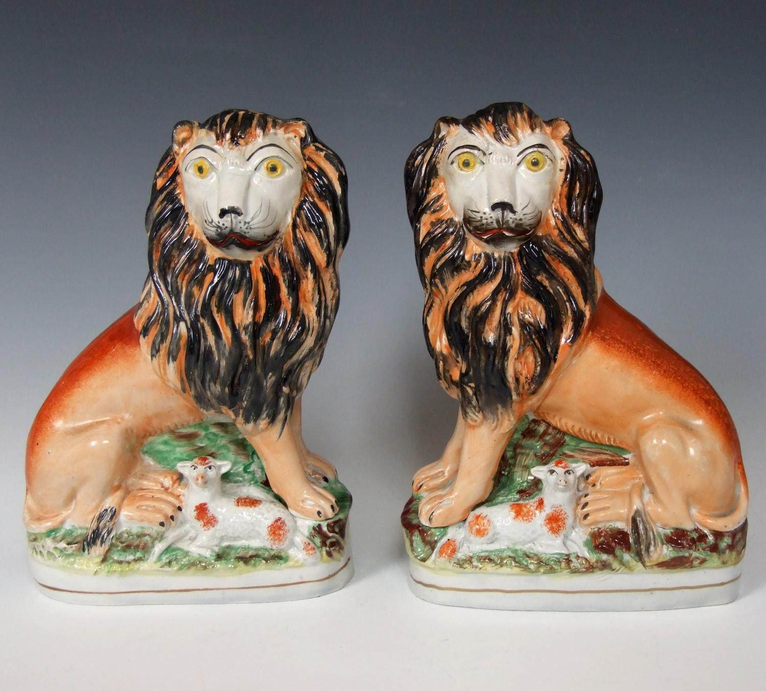 Rare pair of Staffordshire lion & lamb groups
