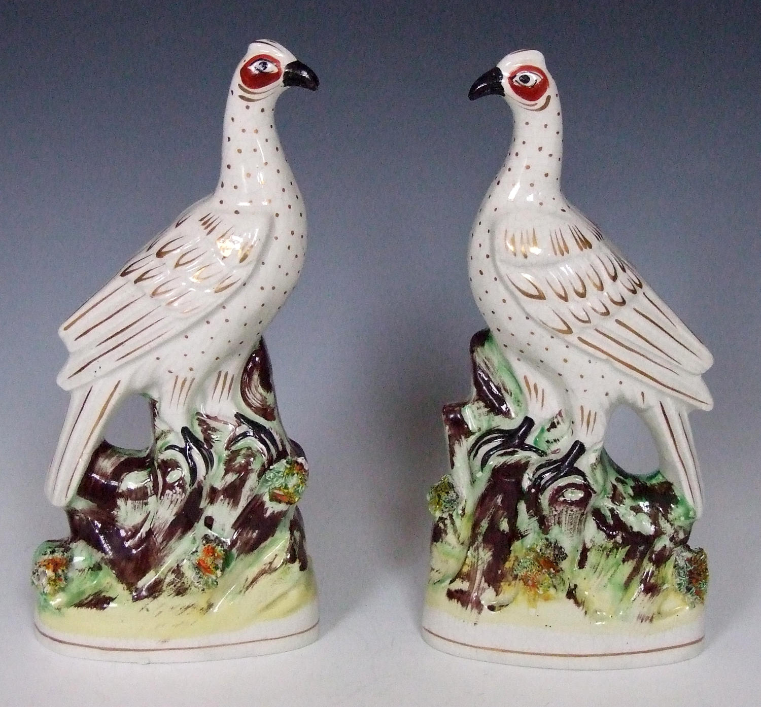 Fine pair of gilt and white Staffordshire bird figures.