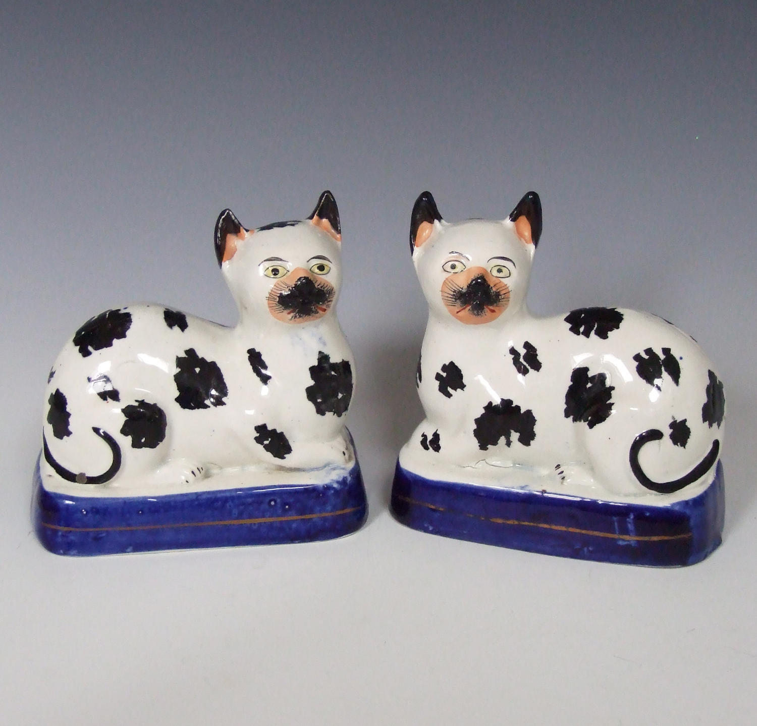 Extremely rare pair of Staffordshire cat figures
