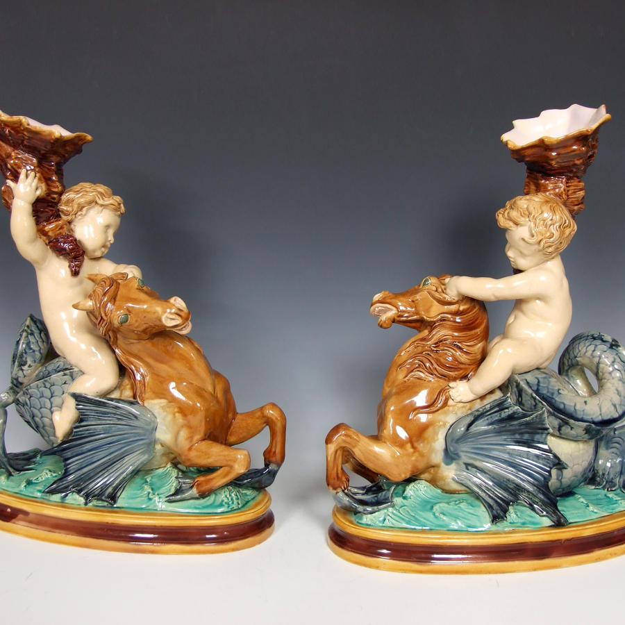 Fabulous pair of Minton majolica seahorse and putto figures