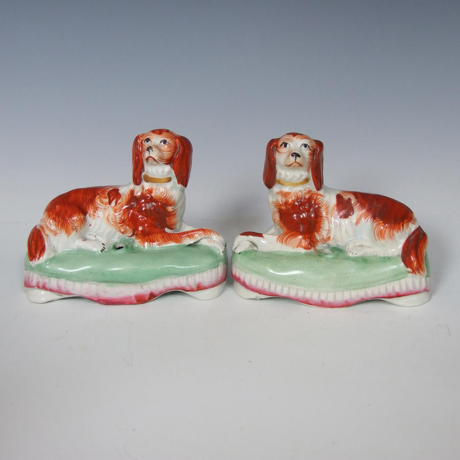 Pair of rare Staffordshire setters on cushions