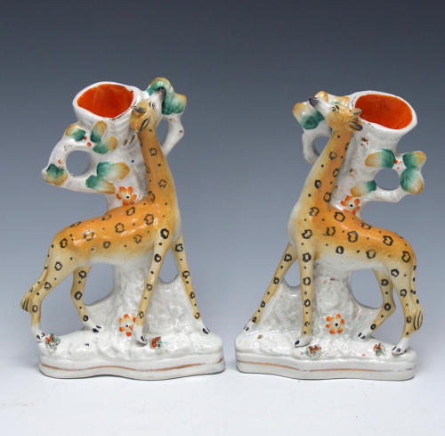 Extremely rare pair of Staffordshire standing giraffe spills