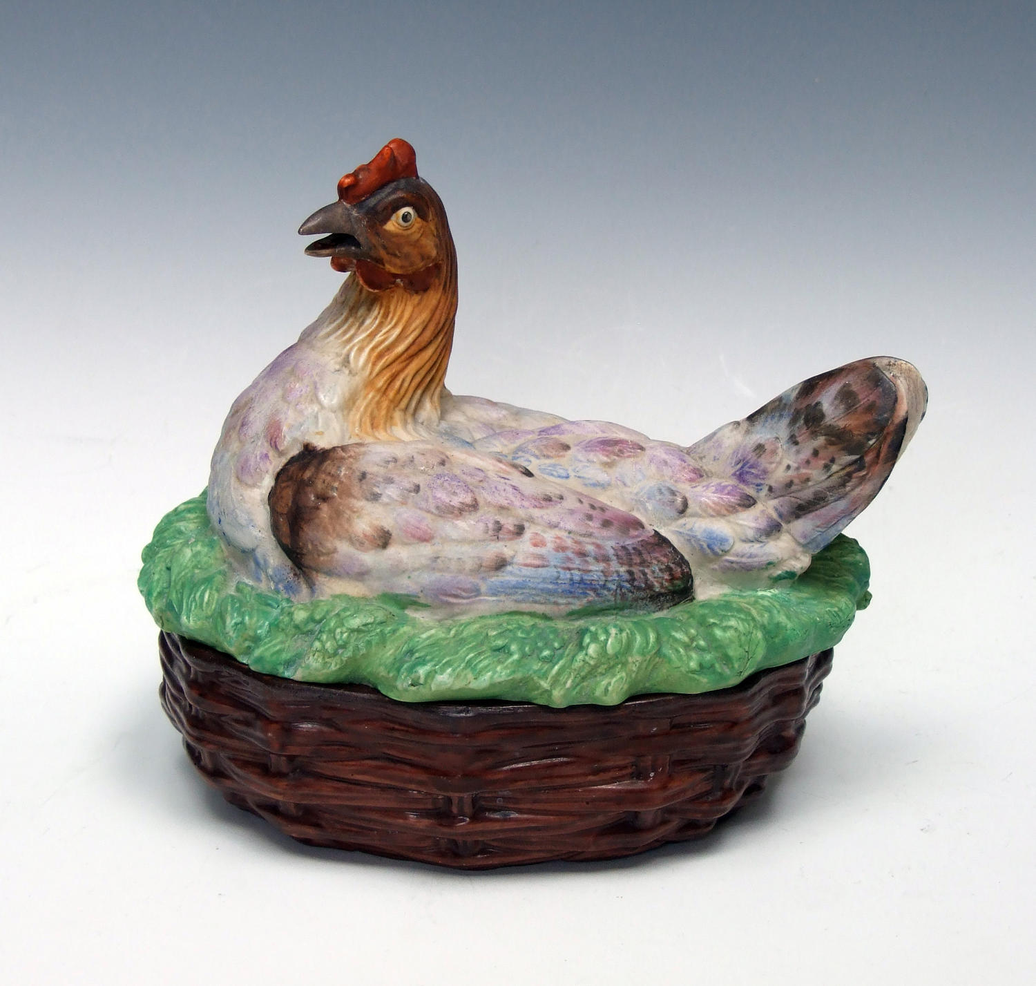 Unusual and colourful hen on basket tureen