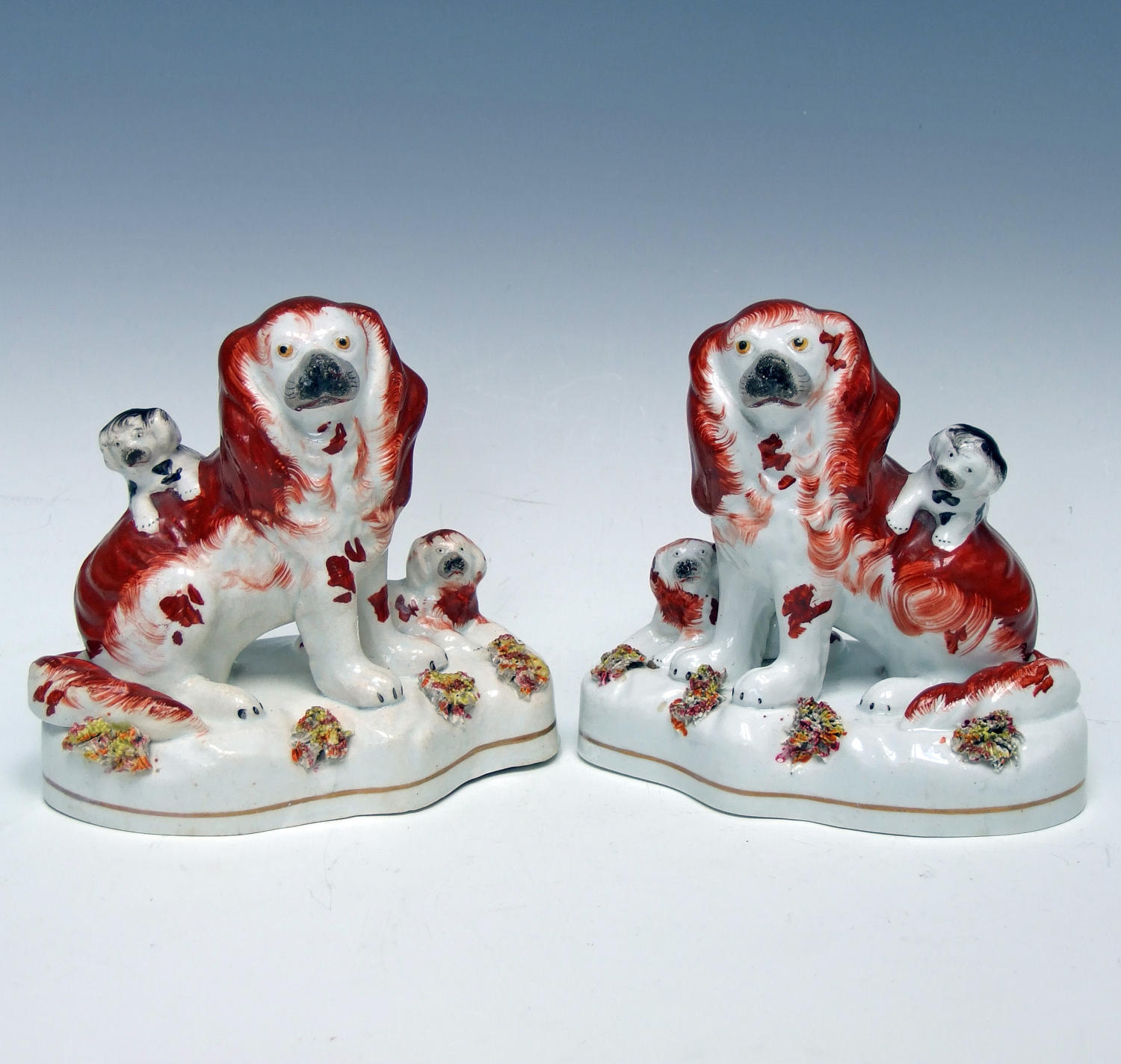 Charming pair of early Staffordshire spaniel and pup figures