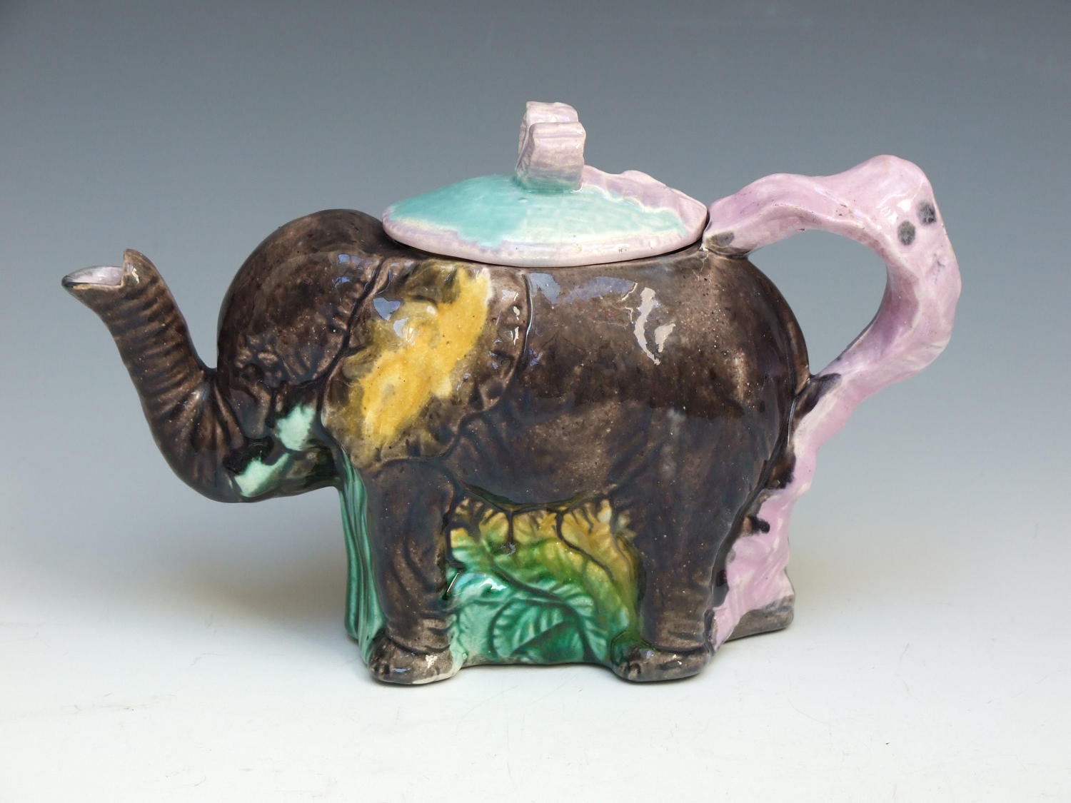 Majolica novelty teapot in the form of an elephant