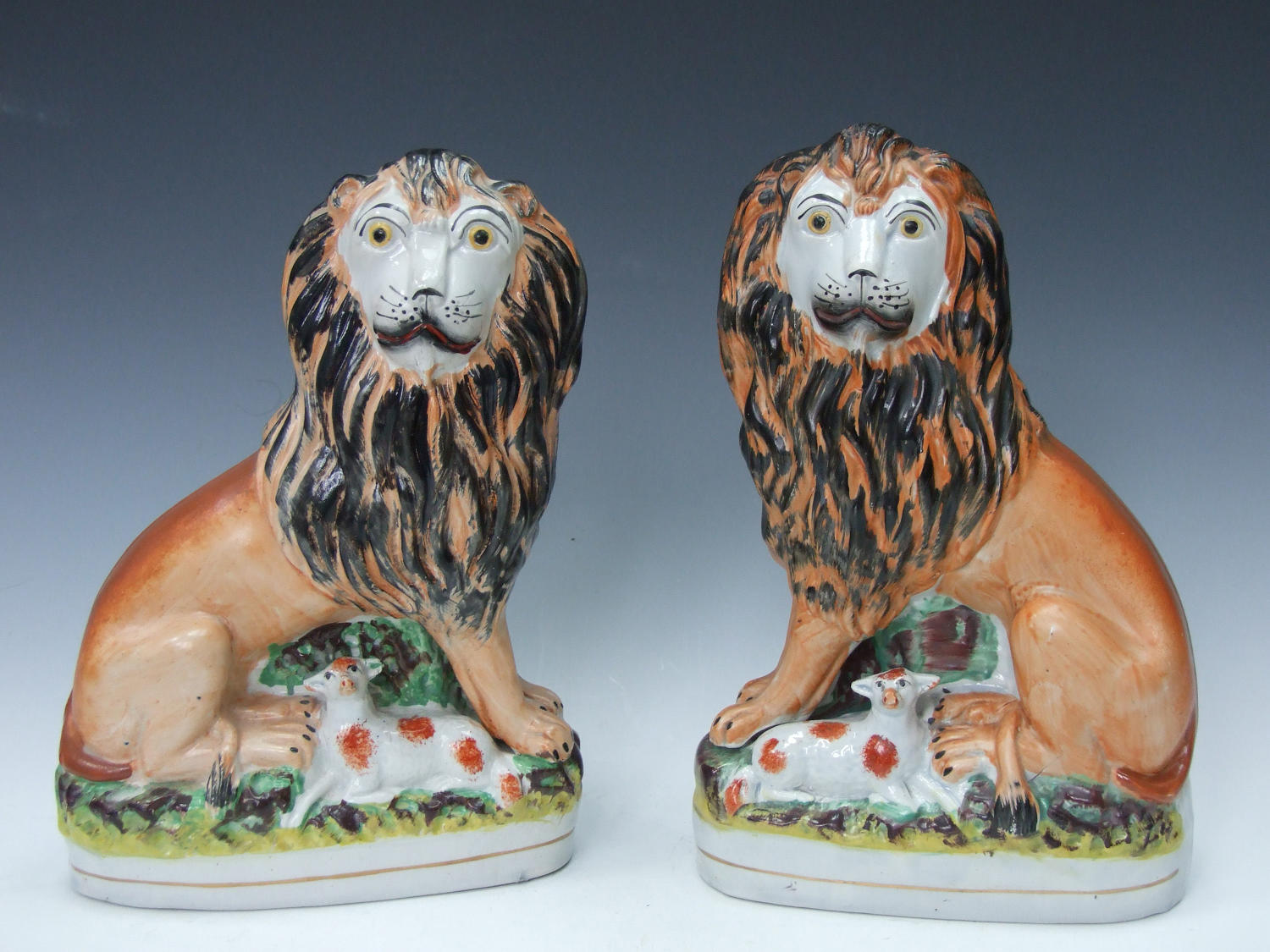Large pair of rare Staffordshire lion & lamb groups