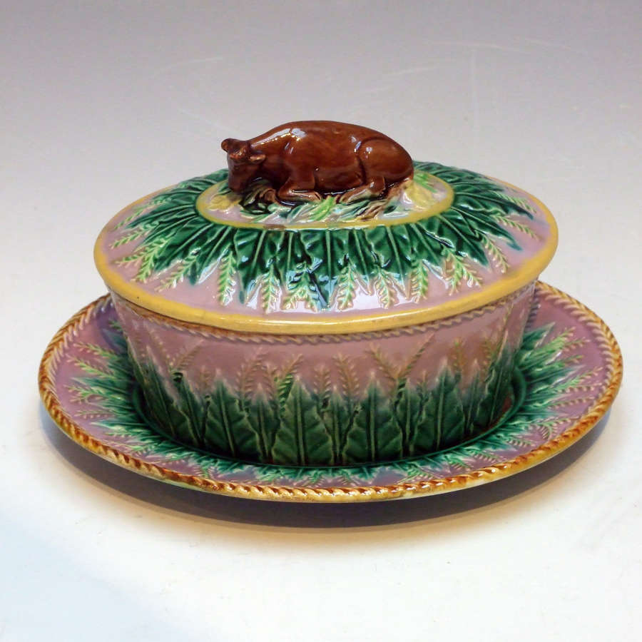 Rare George Jones majolica lilac ground cow finial butter dish