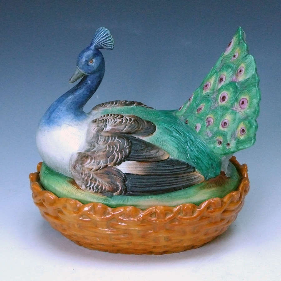A uniquely rare painted bisque peacock motif tureen and cover