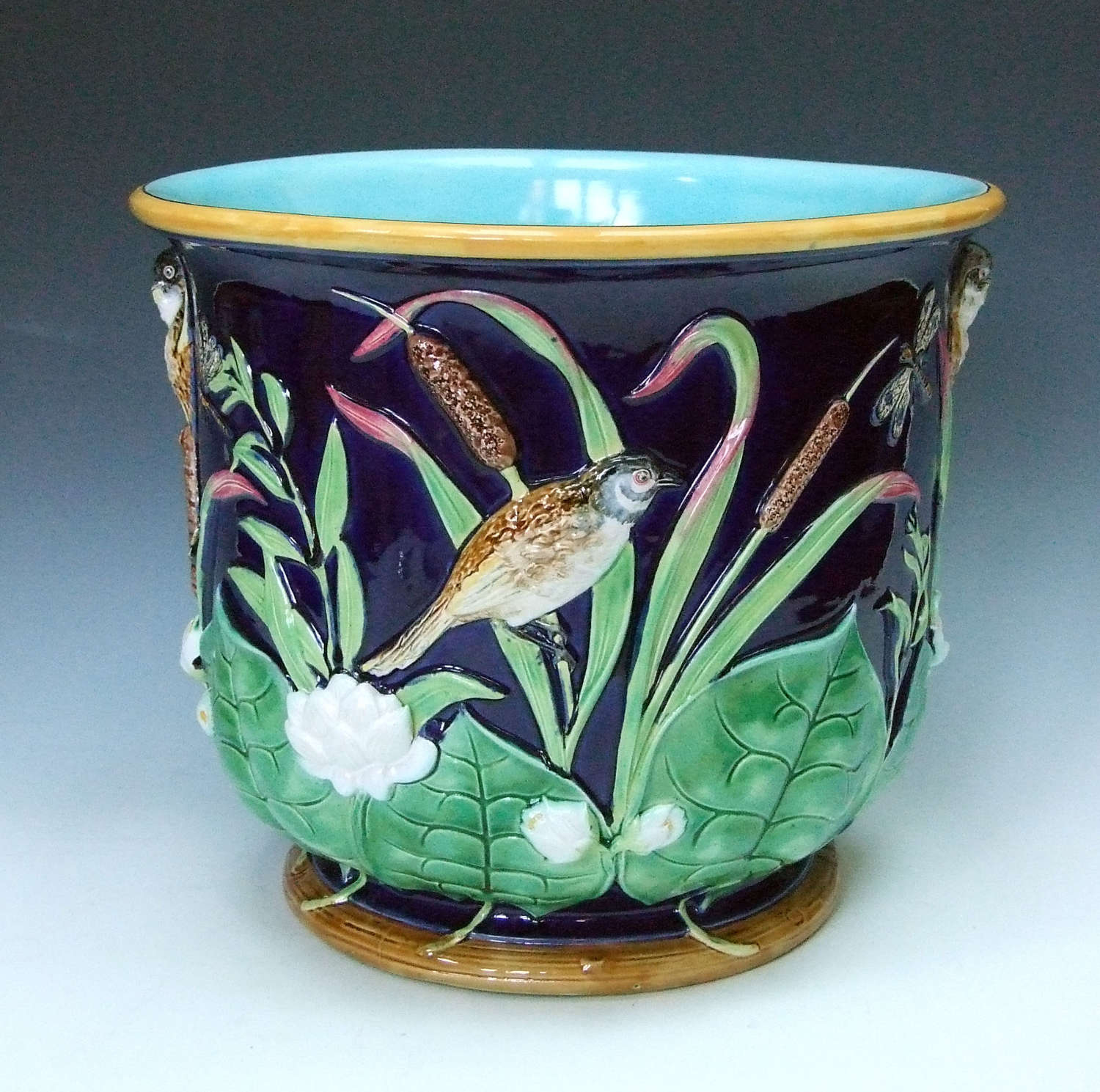Very fine George Jones majolica cobalt ground bird & lily jardiniere