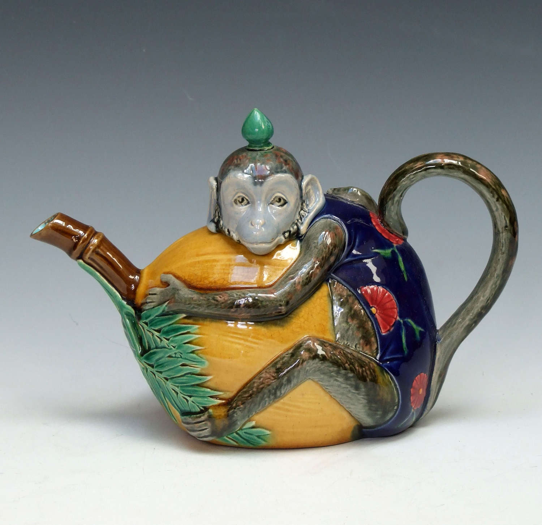 A Minton majolica monkey & coconut novelty teapot.