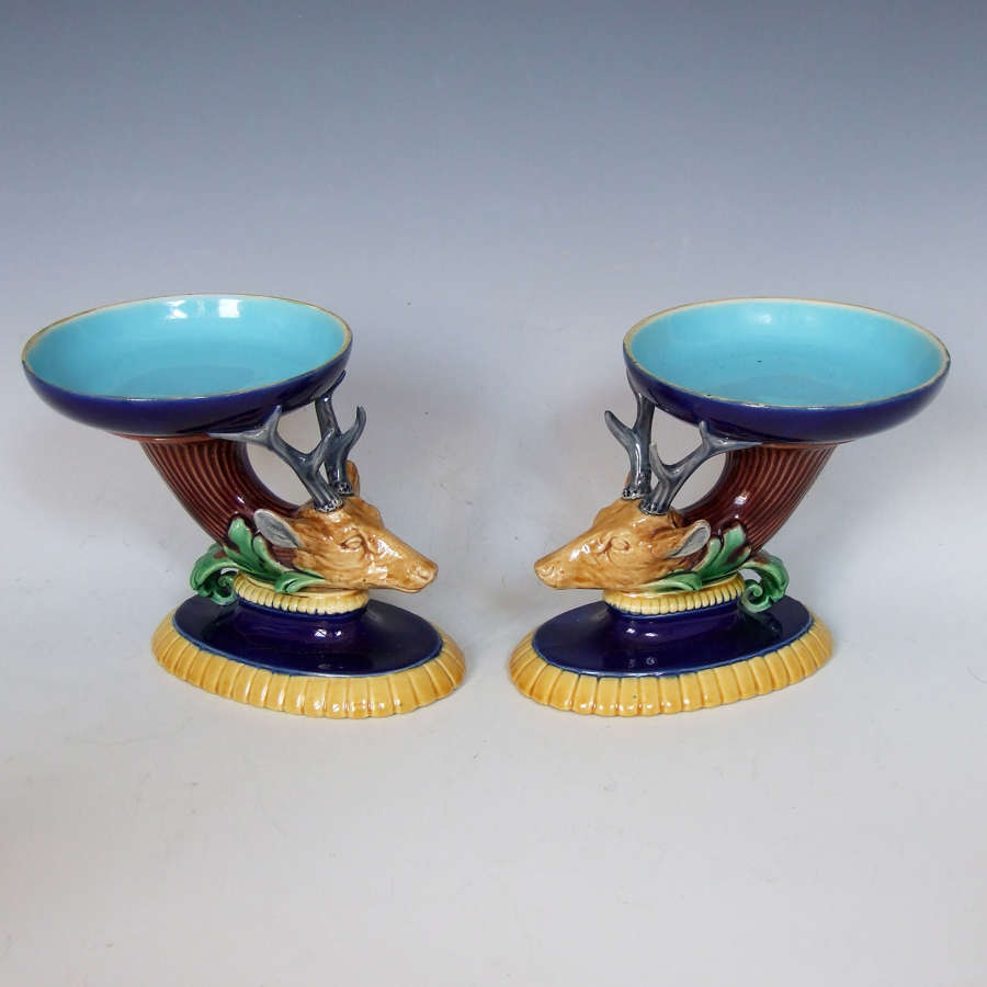 Rare pair of stag head motif Minton majolica salts.