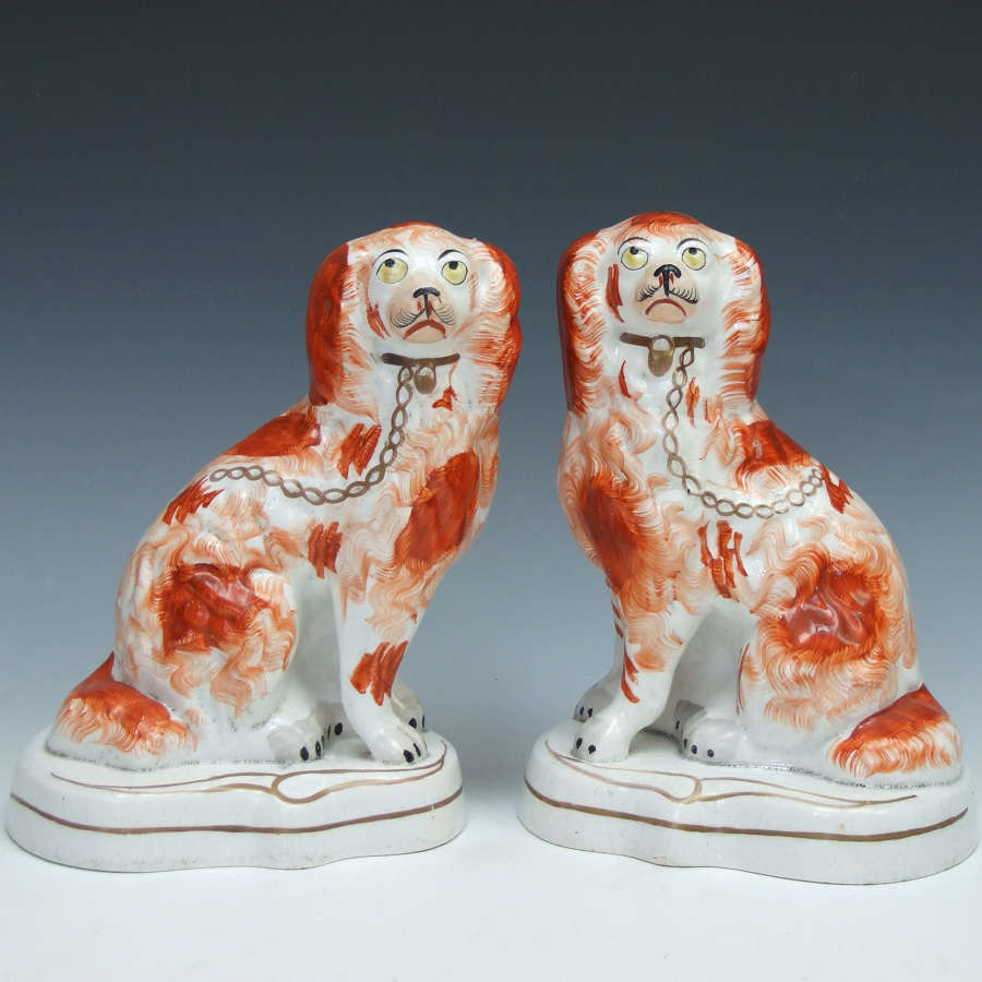Fine pair of early Staffordshire spaniel figures on shaped raised base