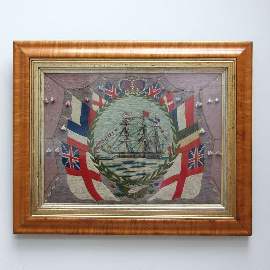 Exceptional sailor's woolwork picture in maple frame.