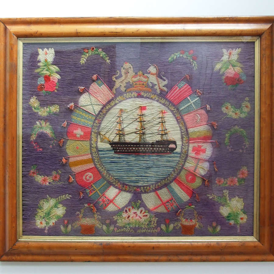 Colourful sailor's woolwork portrait of a Royal Navy ship of the line.