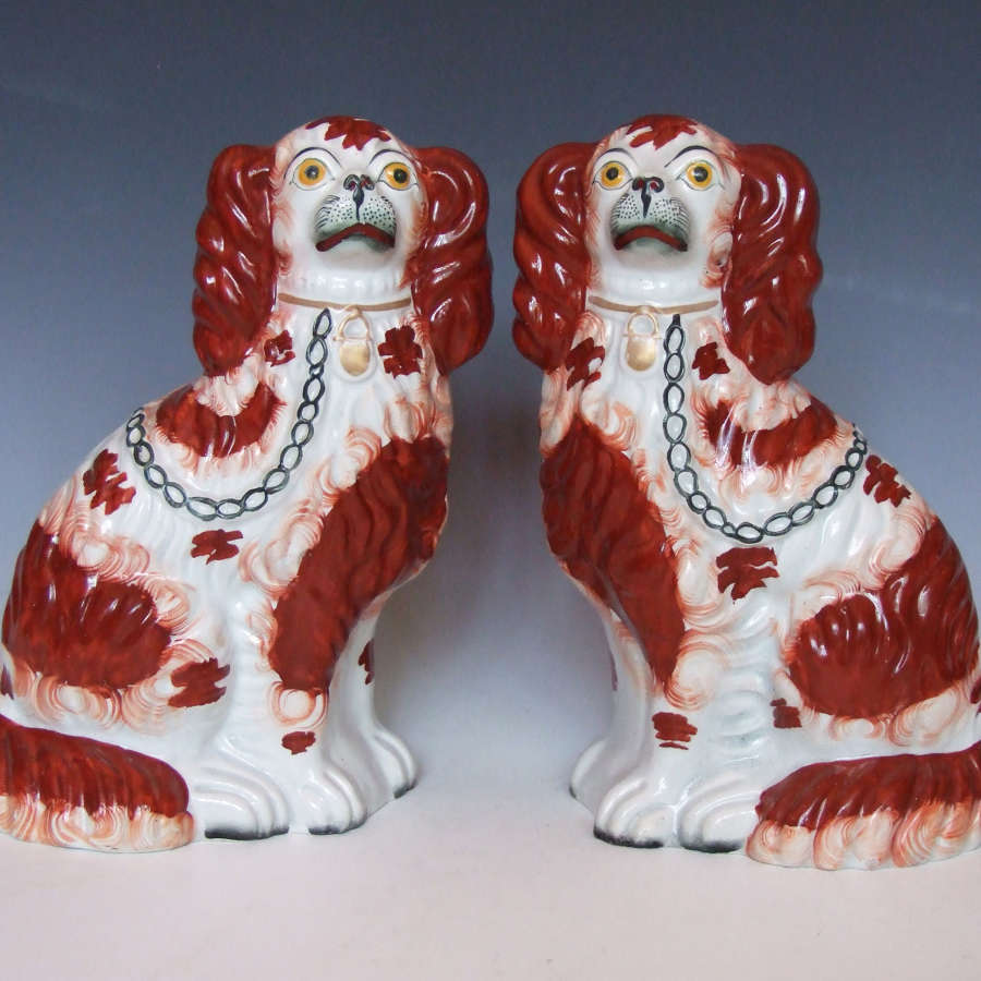 Fine pair of red and white Staffordshire spaniel figures.