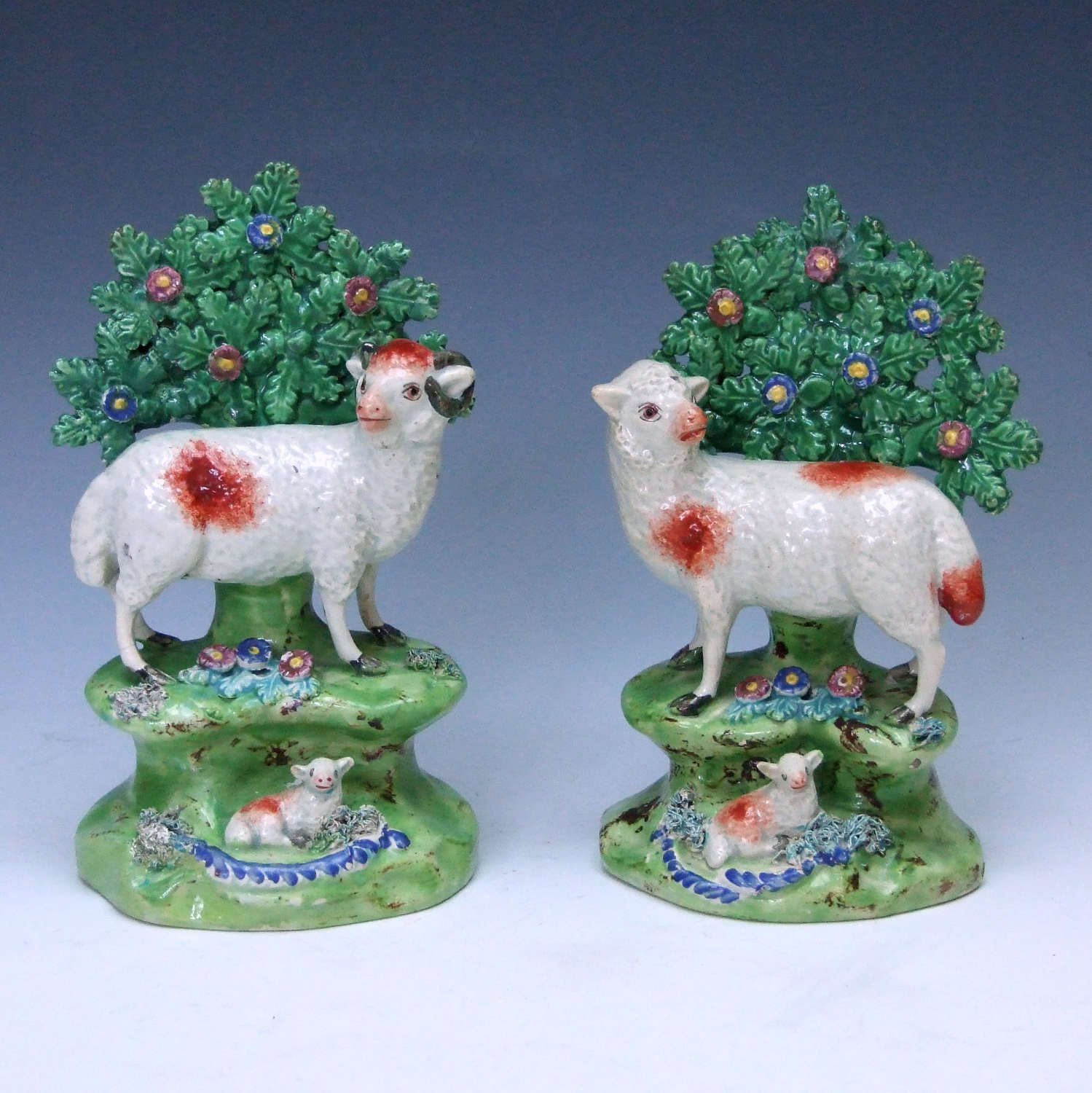 A rare pair of early 19thC pearlware Staffordshire sheep figures.