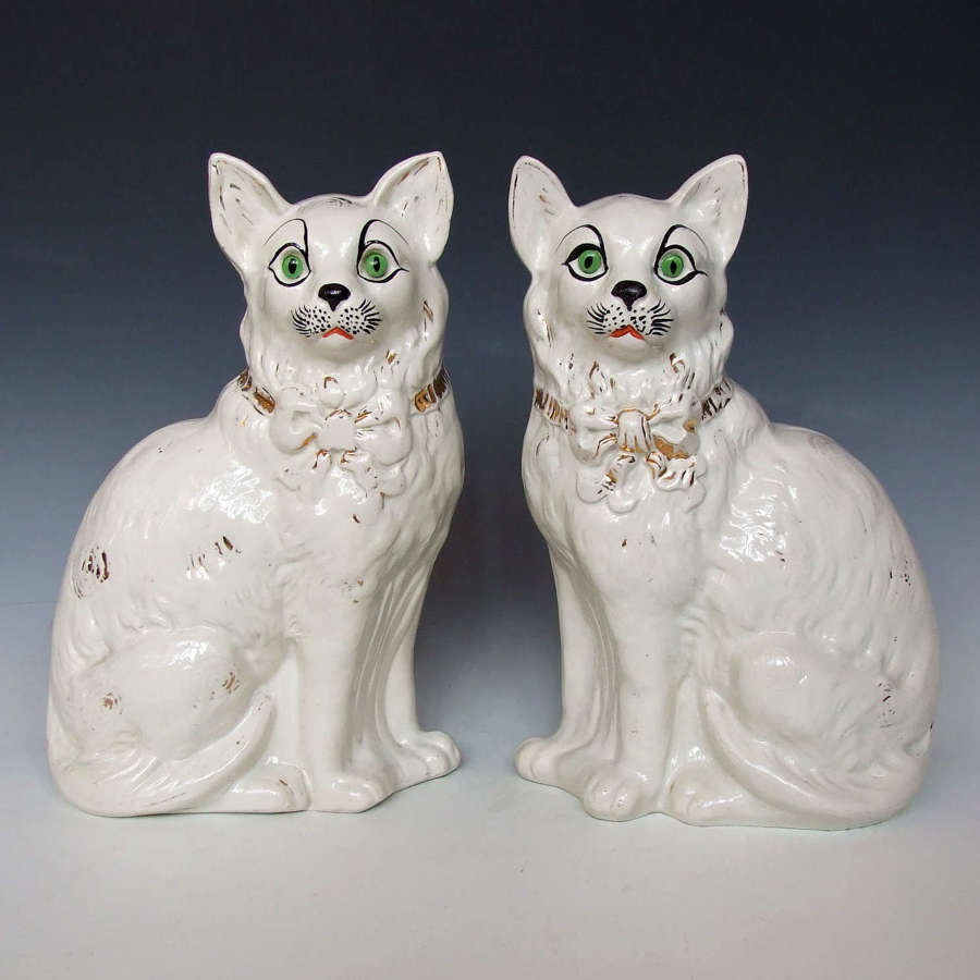 Rare & unusual large pair of white Staffordshire cat figures.