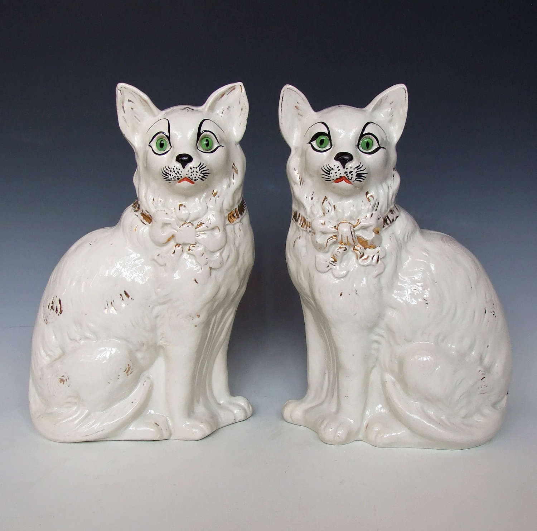 Rare & unusual large pair of white Staffordshire cat figures.