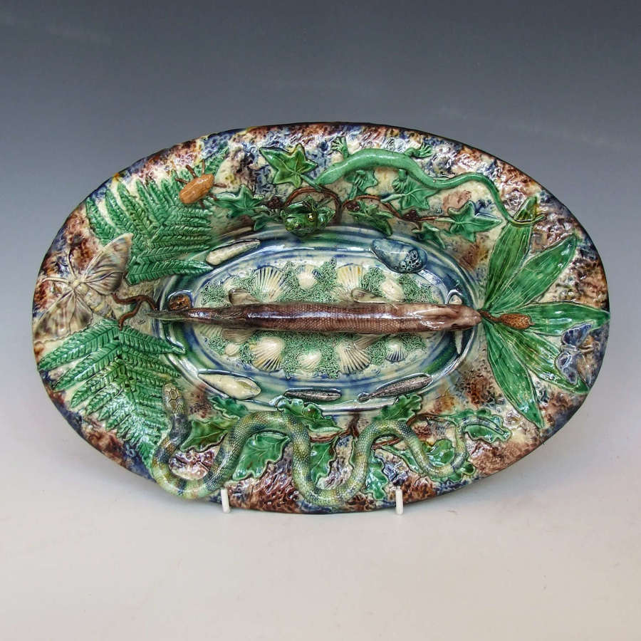 A beautiful French Palissy oval charger with central figure of a pike.