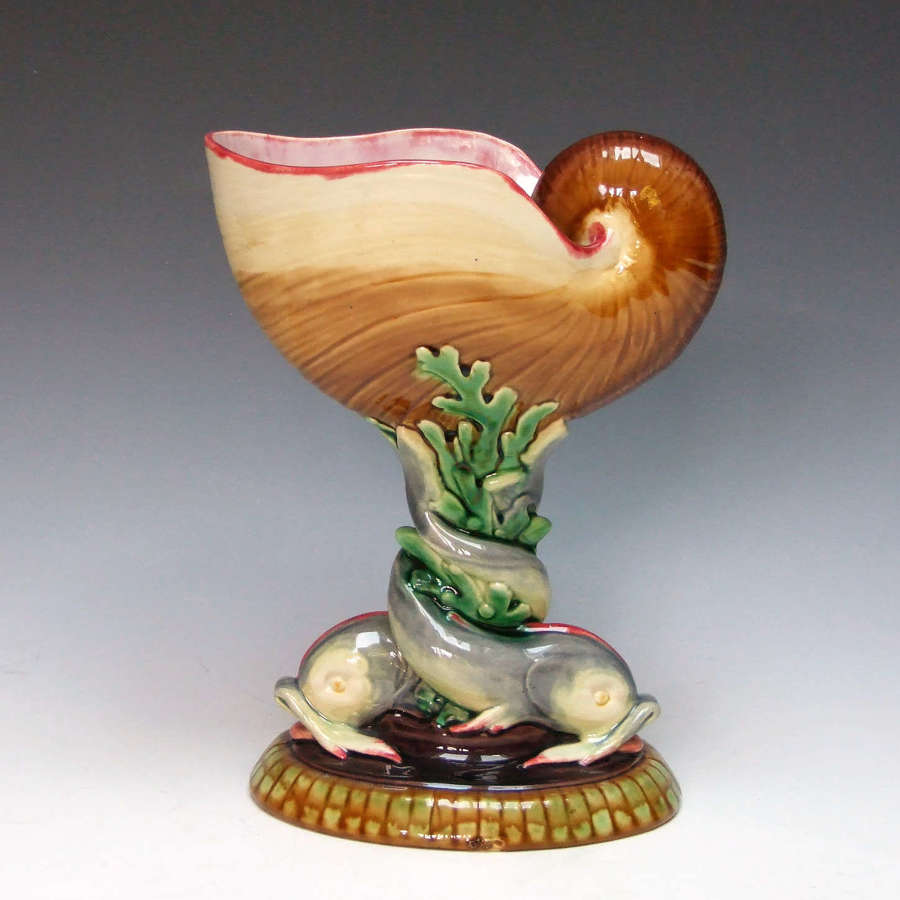 A beautiful Minton majolica nautilus shell and dolphin coupe.