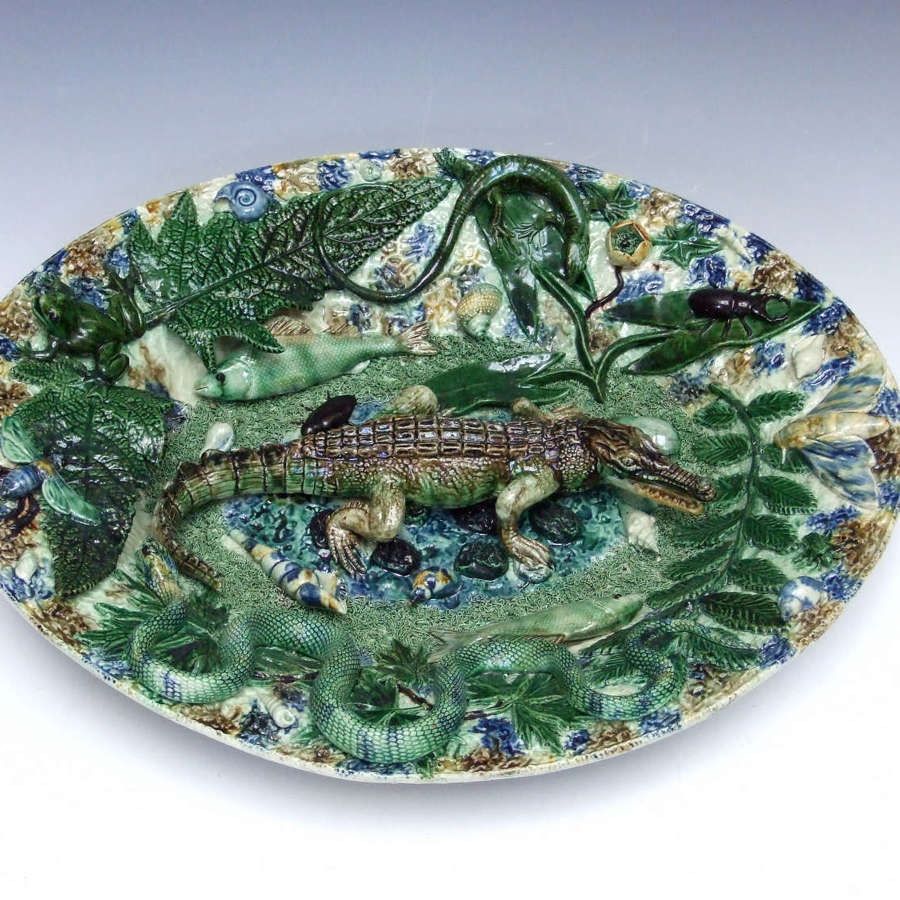 An extremely rare and impressive Palissy crocodile motif charger.