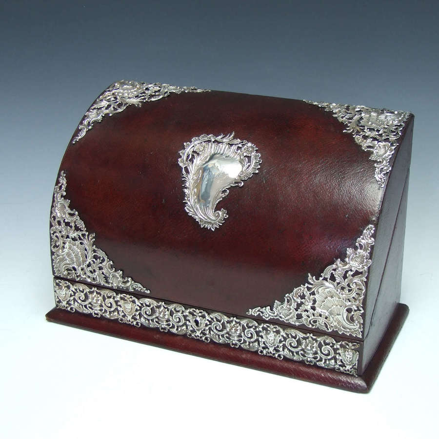 A lovely silver and leather domed stationery box.